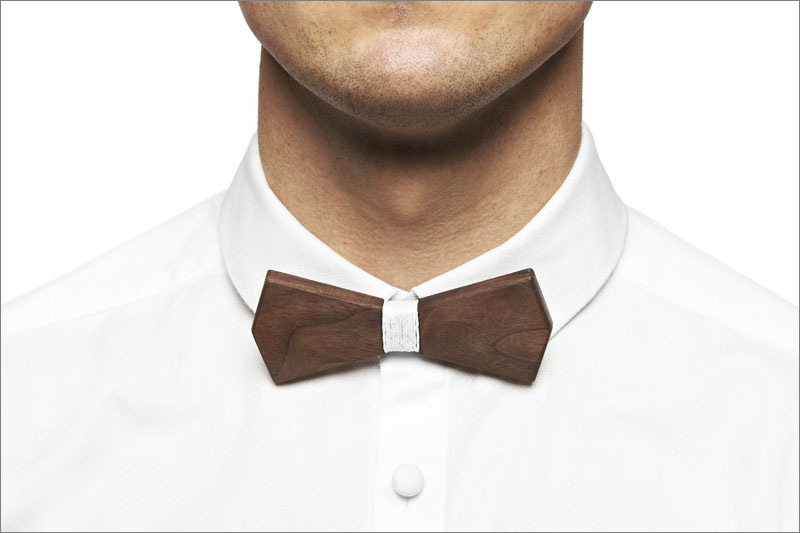 The contrast between the dark wood and the white string wrapped around the center gives this modern wood bow tie a contemporary look that's neutral enough to be worn with any men's outfit