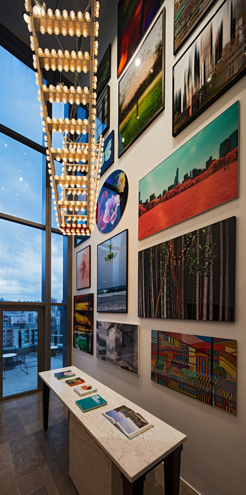This modern clubhouse has a large wall gallery full of art.