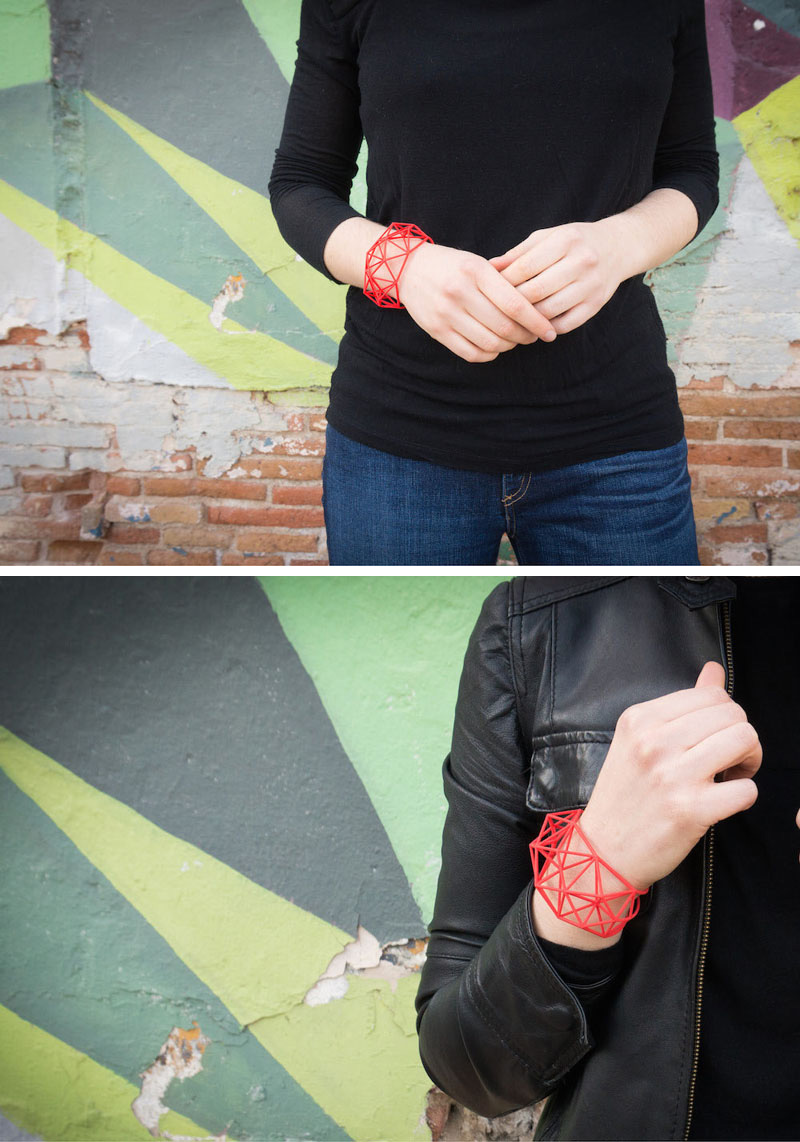 These modern red geometric bracelets are 3D printed using nylon and plastic as the main materials.