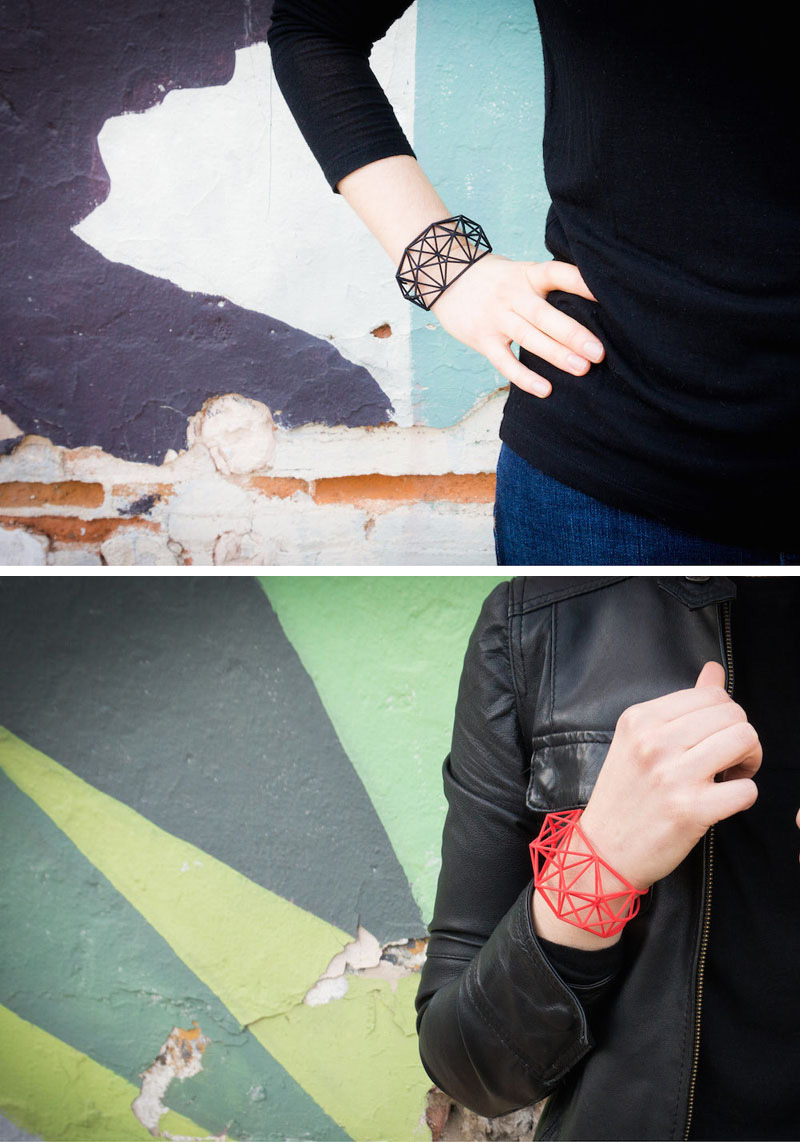These modern geometric bracelets are black and red, and are 3D printed using nylon and plastic as the main materials.