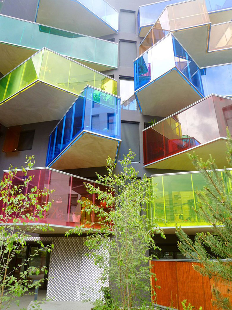 These vibrant colored modern glass balconies appear as if they have no logical or repetitive shapes, making them intriguing to look at.