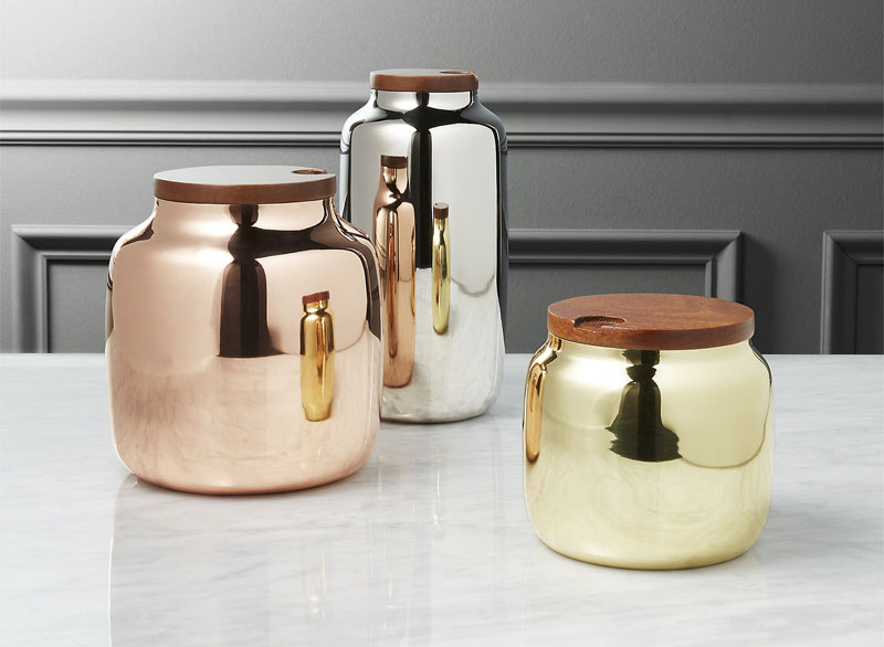 With gold, silver, and copper finishes, these stainless steel canisters are perfect for the modern kitchen. A gorgeous, notched mango wood lid allows for easy access to the contents inside.
