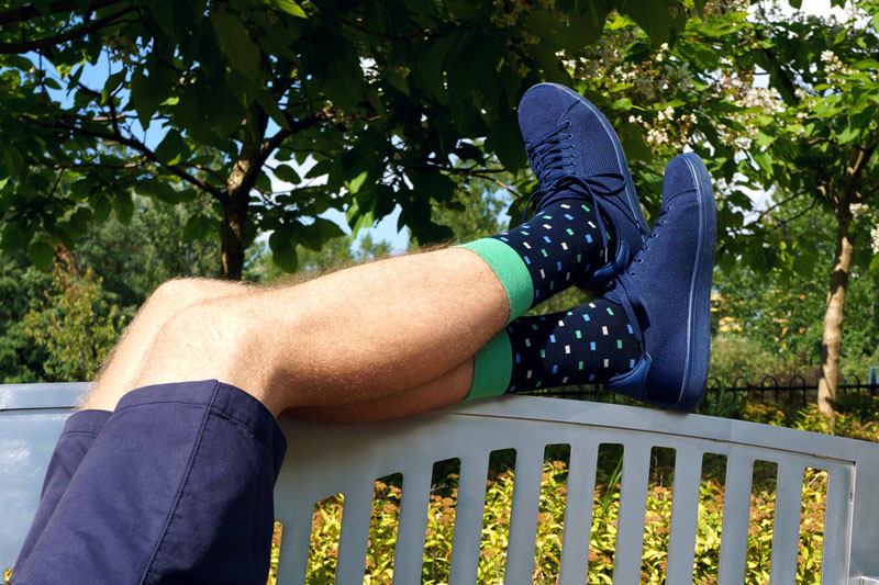 These multi-colored patterned socks have a bold green band making them modern and standout.