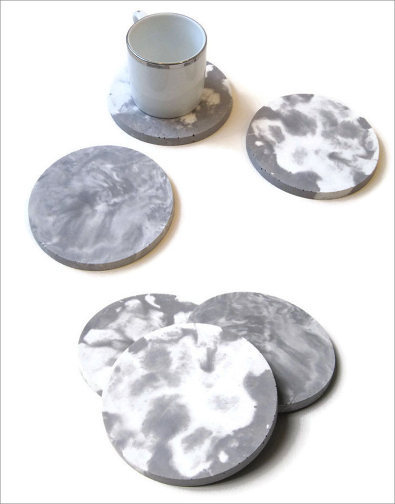 Simple grey and white, circular marble concrete coasters add style and sophistication to your modern home decor