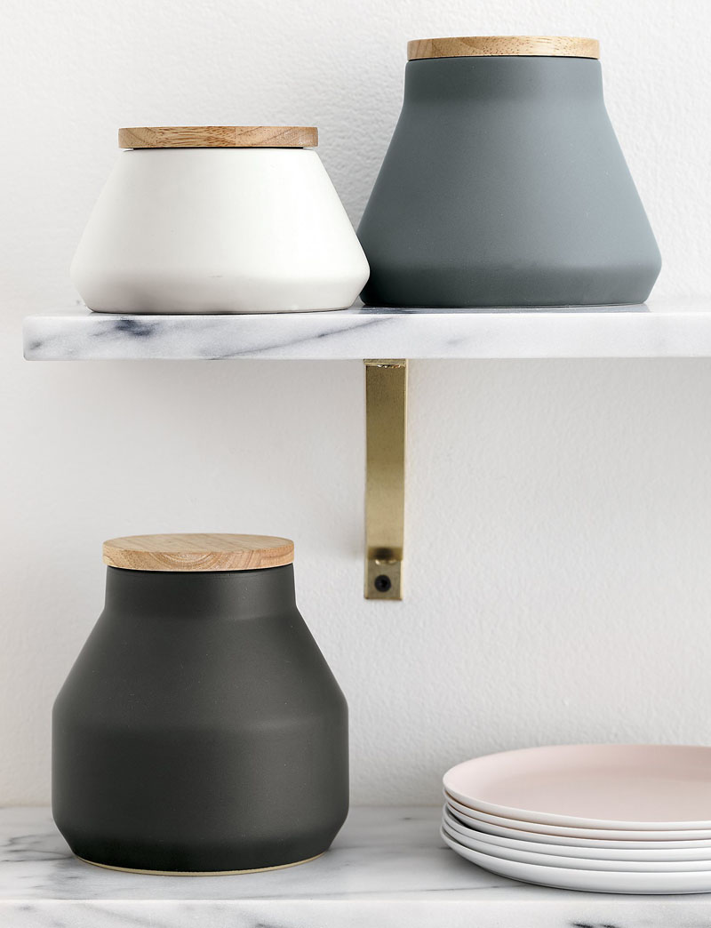 Unique in shape, these tapered stoneware canisters help keep items fresh with rubberwood lids. The neutral colors make them suitable for any modern kitchen.