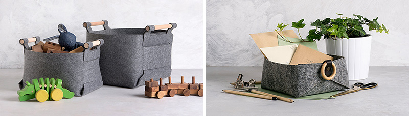 These modern grey storage baskets are made from industrial grade felt, brass snaps, and wood handles.