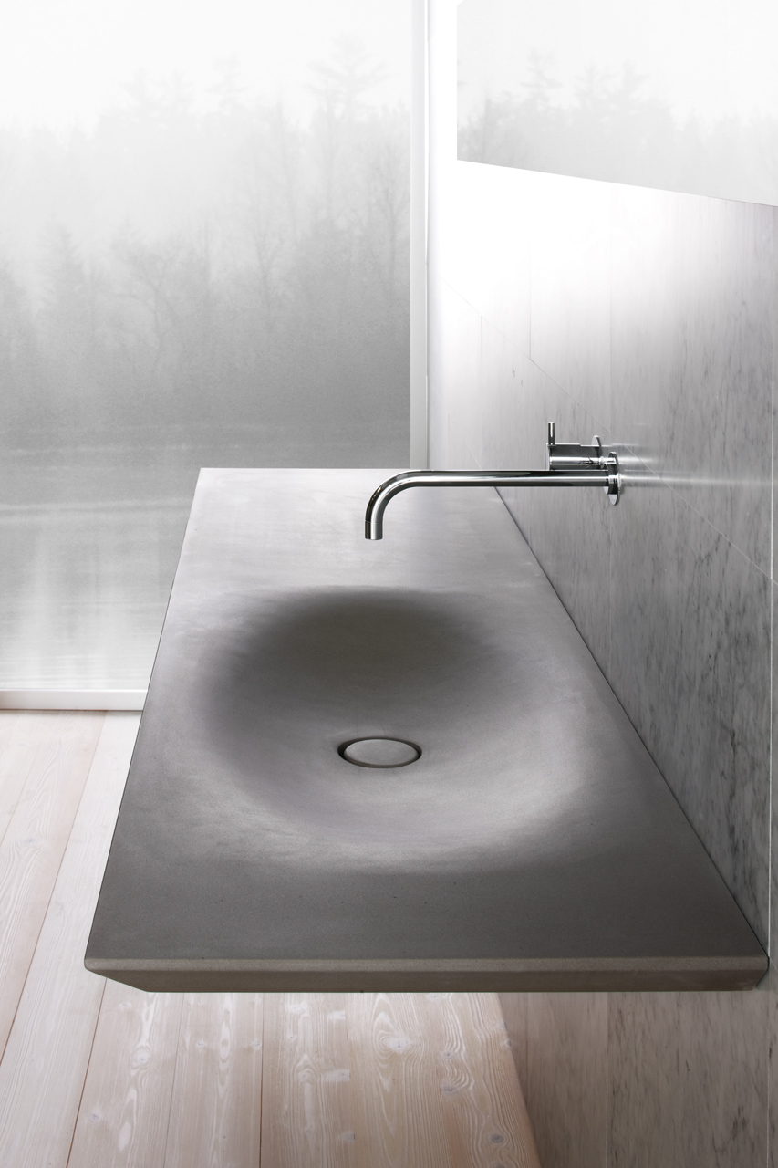 This modern sink has all of the benefits of an integrated sink as well as the benefits of having grey stone countertops, including durability.