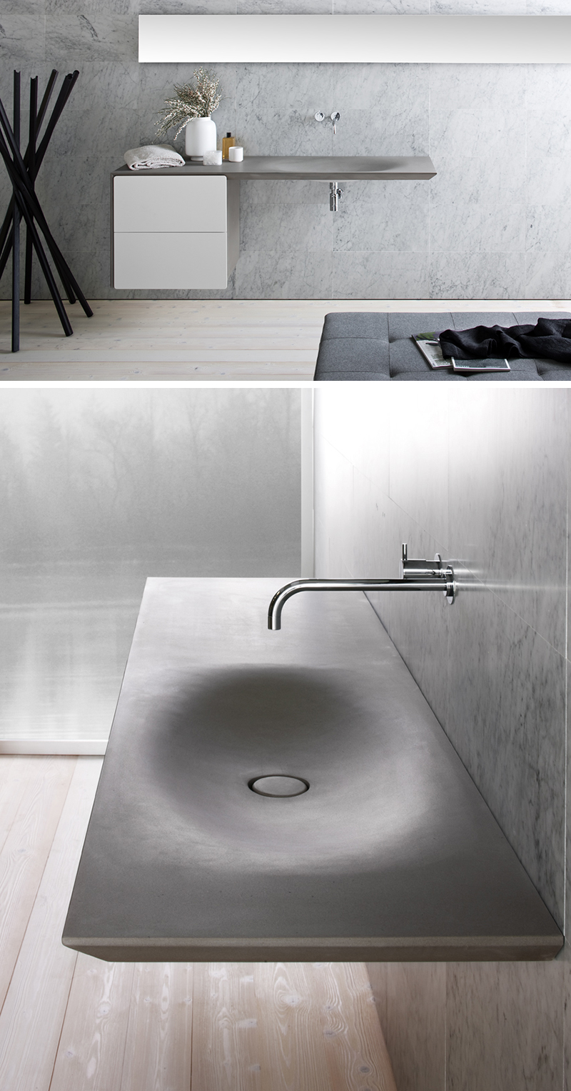 Great This modern seamless grey stone sink is wall mounted with two white drawers and a