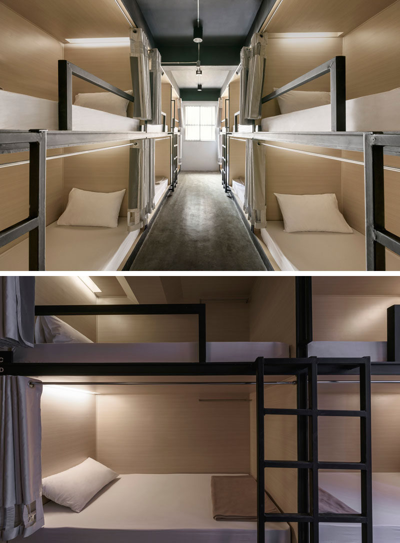 This modern hostel in Bangkok has rooms that are set up in a bunk bed arrangement, with each bunk having their own curtain and reading lamp.