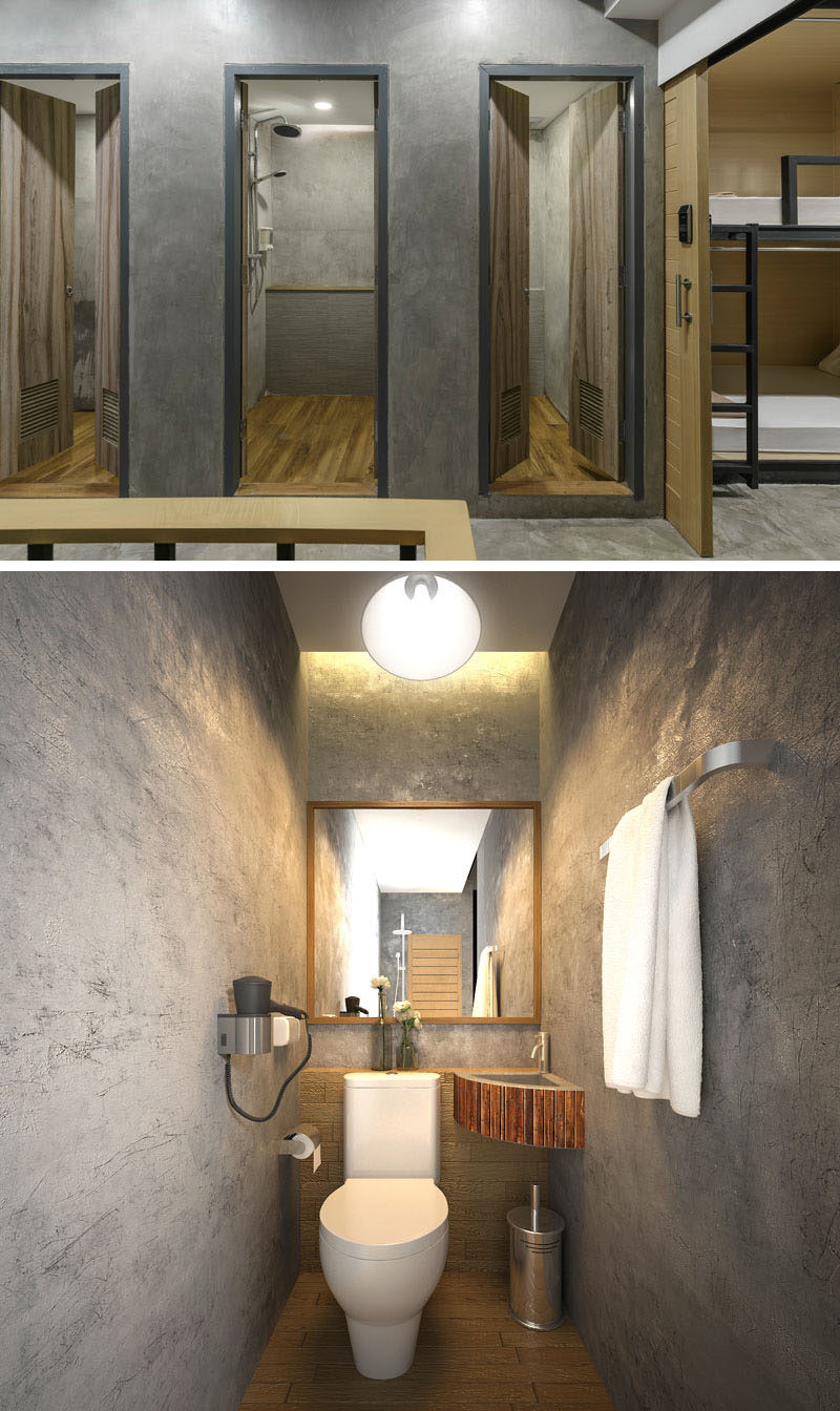 The bathrooms in this modern hostel, can be found on each floor and they are minimal in their design, with wood doors and concrete walls.