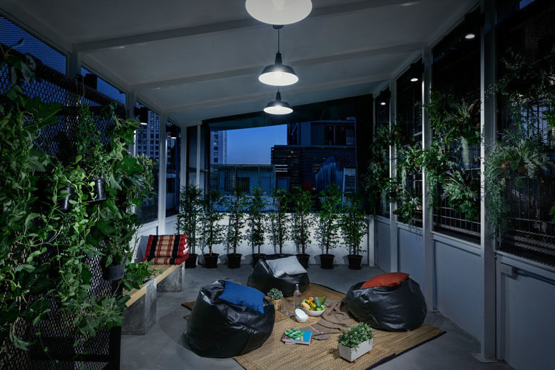 This modern hostel in Bangkok has a communal outdoor space for relaxing and enjoying the city views.