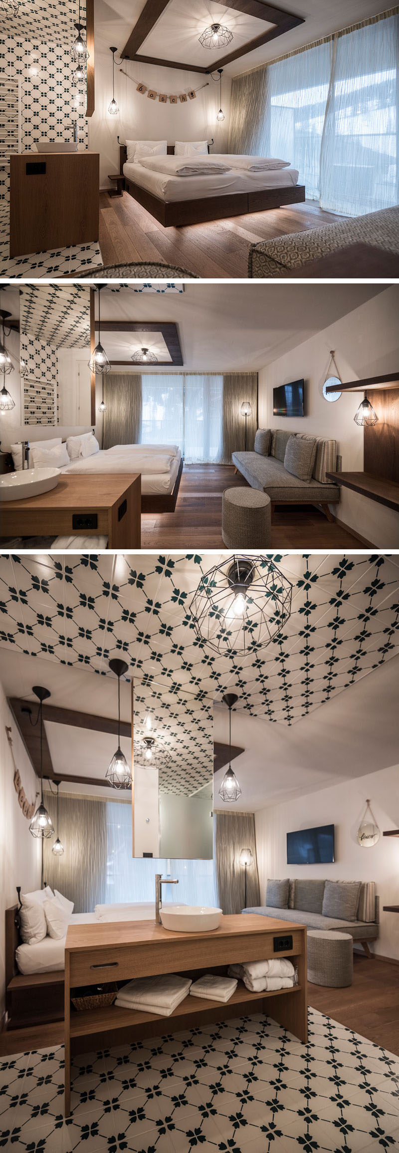 Green and white tiles designate the washroom in this modern hotel room, that has a mirror hanging from the ceiling and a wood vanity. The bed sits opposite the gray sofa, and appears to be floating because of the LED lights hidden underneath.