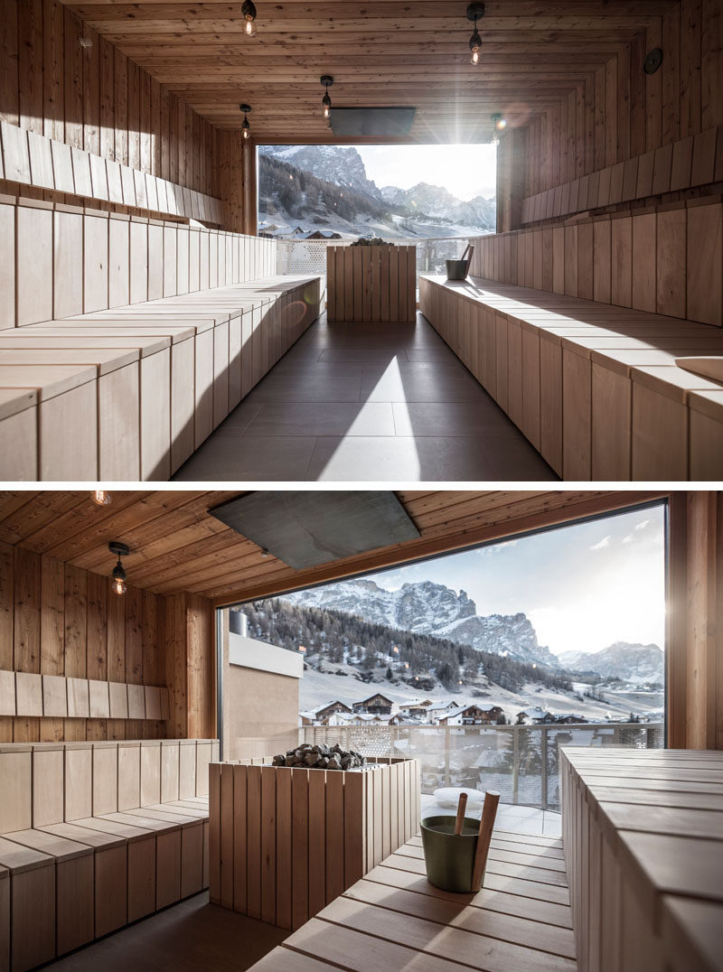 This modern hotel has a spacious sauna that's paneled in light wood, and has a floor to ceiling window at the end of the room that allows for views of the mountains.