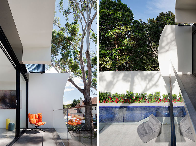 Crescent shapes at each end of this balcony provide privacy and a sculptural touch to this modern house.