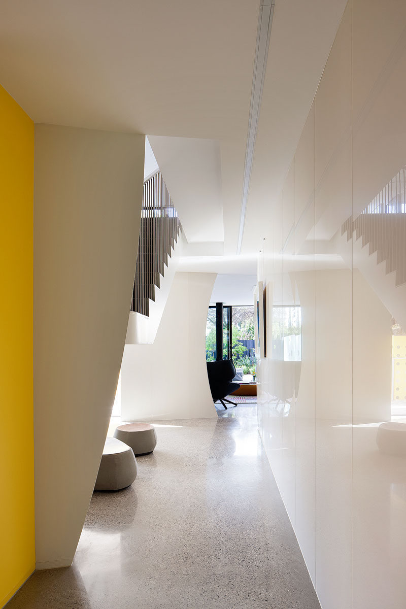 The flooring throughout this modern house is a hand-crafted polished concrete floor.