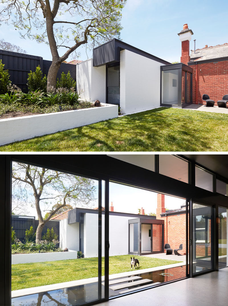This old brick house has a modern extension, with the 'pod' on the left home to two new bedrooms, with one of them looking out to the garden through a vertical window.