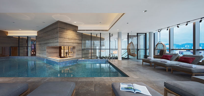 The modern clubhouse has an indoor swimming pool and lounging area with picturesque views of Hong Kong.