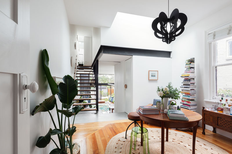 This renovated house has a small library before heading upstairs.