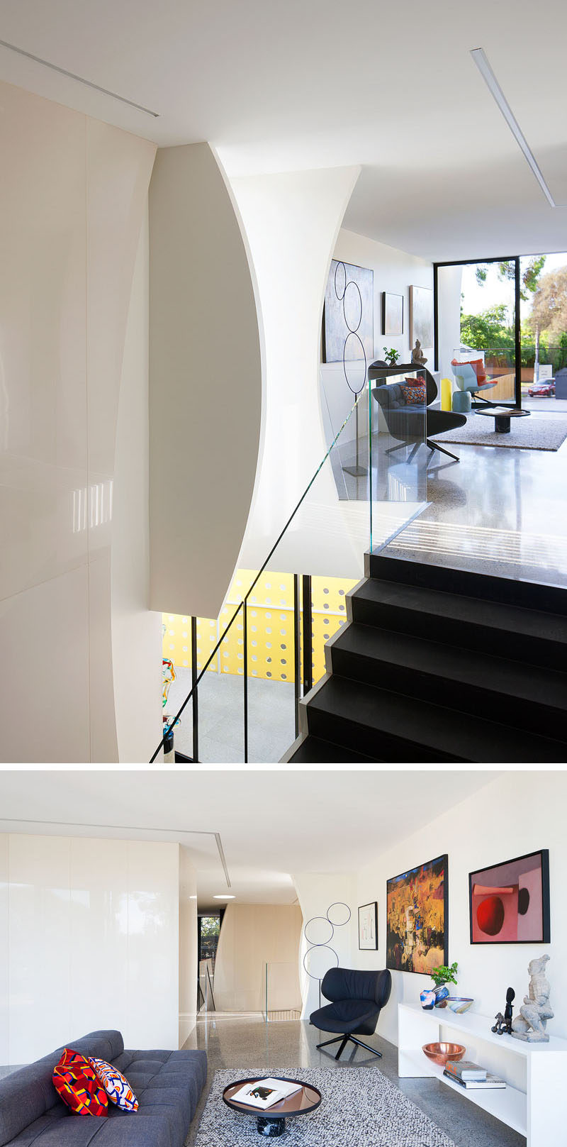 At the top of the stairs in this modern house, there's a small gallery area with multiple pieces of artwork and a sitting area to sit back, relax and appreciate the art pieces.