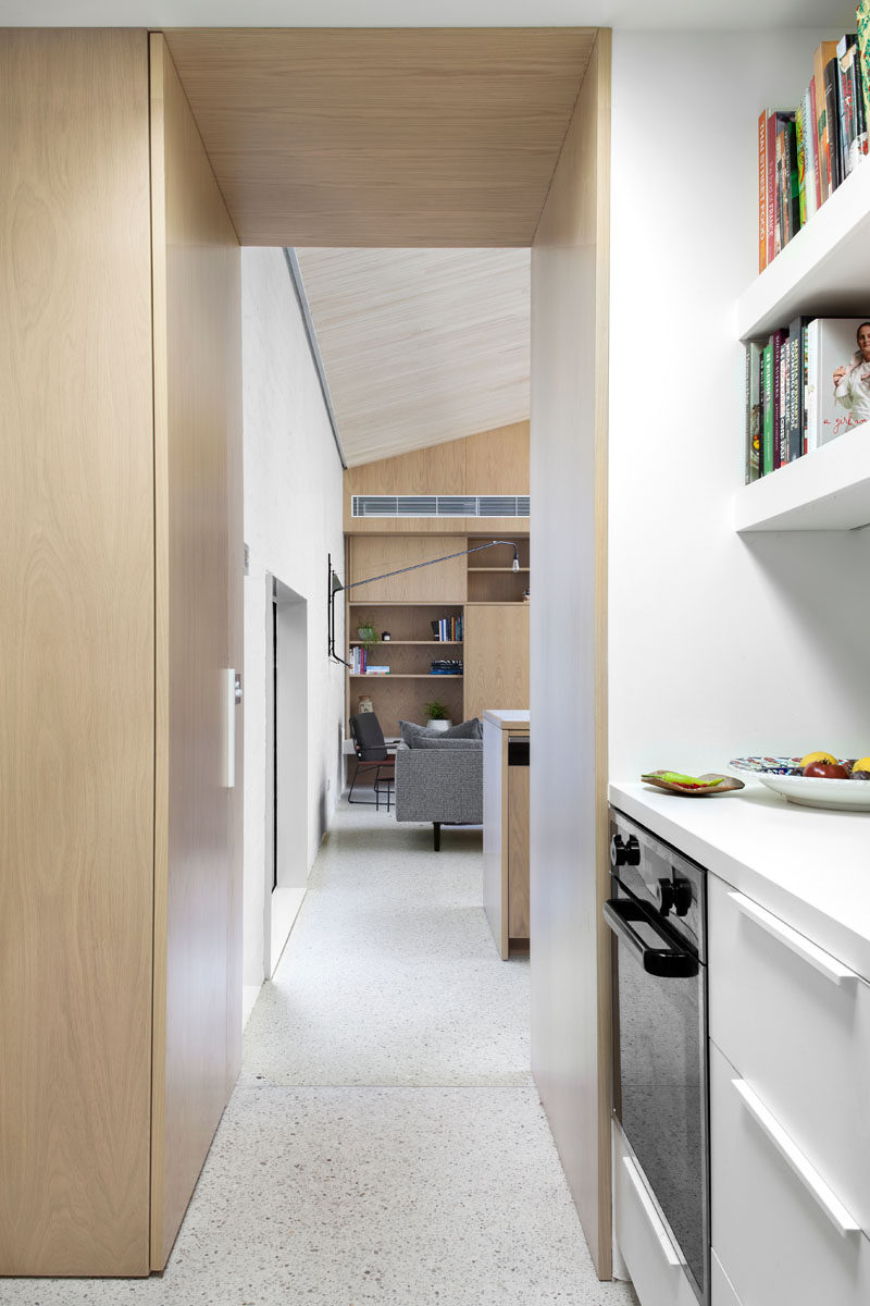 This modern pantry has plenty of additional storage with cabinets, drawers and open shelving.
