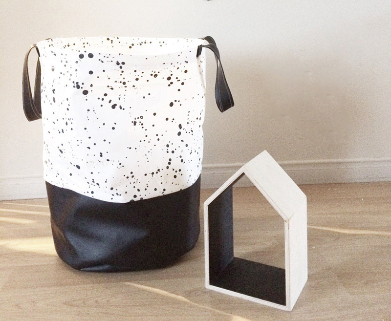 Made with 100% cotton fabric and faux leather, this funky black and white speckled laundry hamper is perfect in any room.