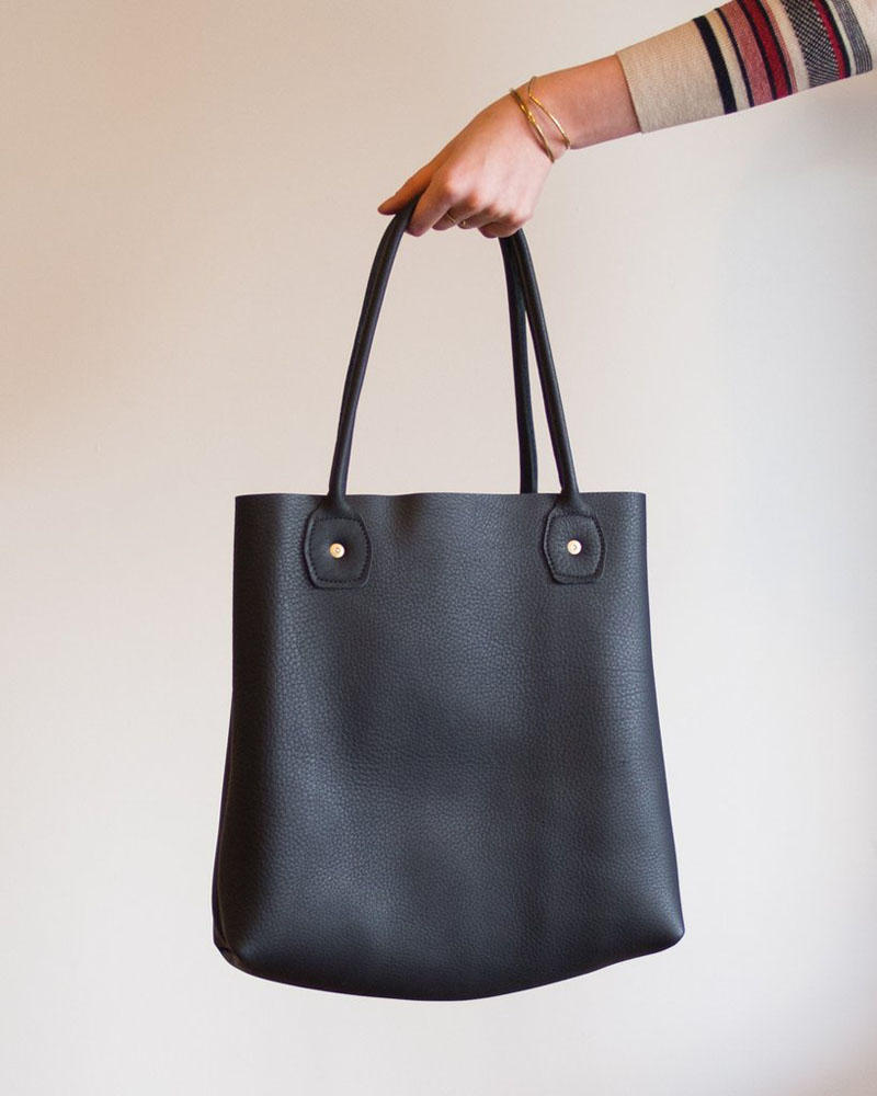 This modern black leather tote slouches perfectly and is very sturdy.