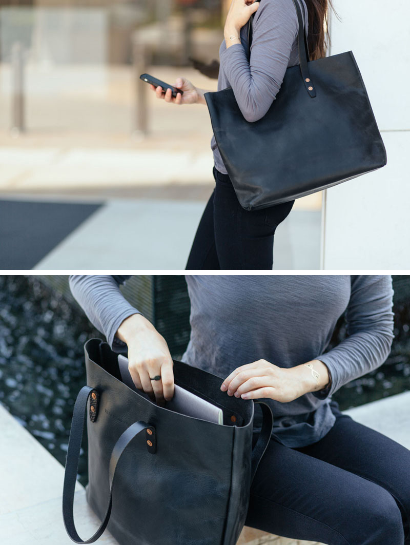 This modern black leather bag features an interior pocket, copper rivets, and a solid bottom to make it the perfect everyday tote.