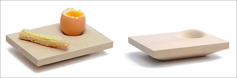 This modern light wood egg cup also has a place for a piece of toast to enjoy with your hard boiled egg.