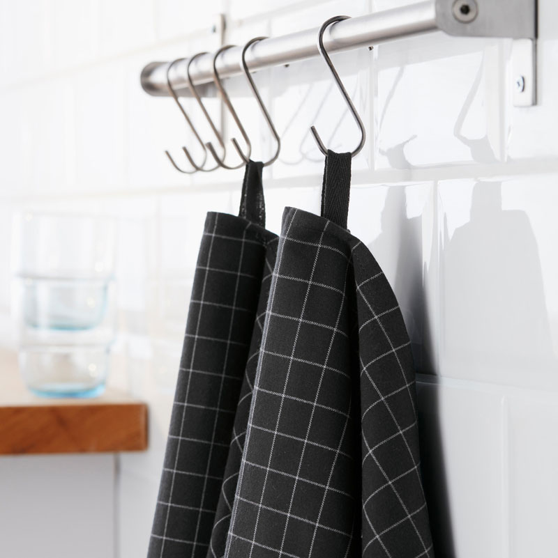 Keep on top of spills with these modern black tea towels that can easily be hung from hooks or casually draped over your shoulder while you work.