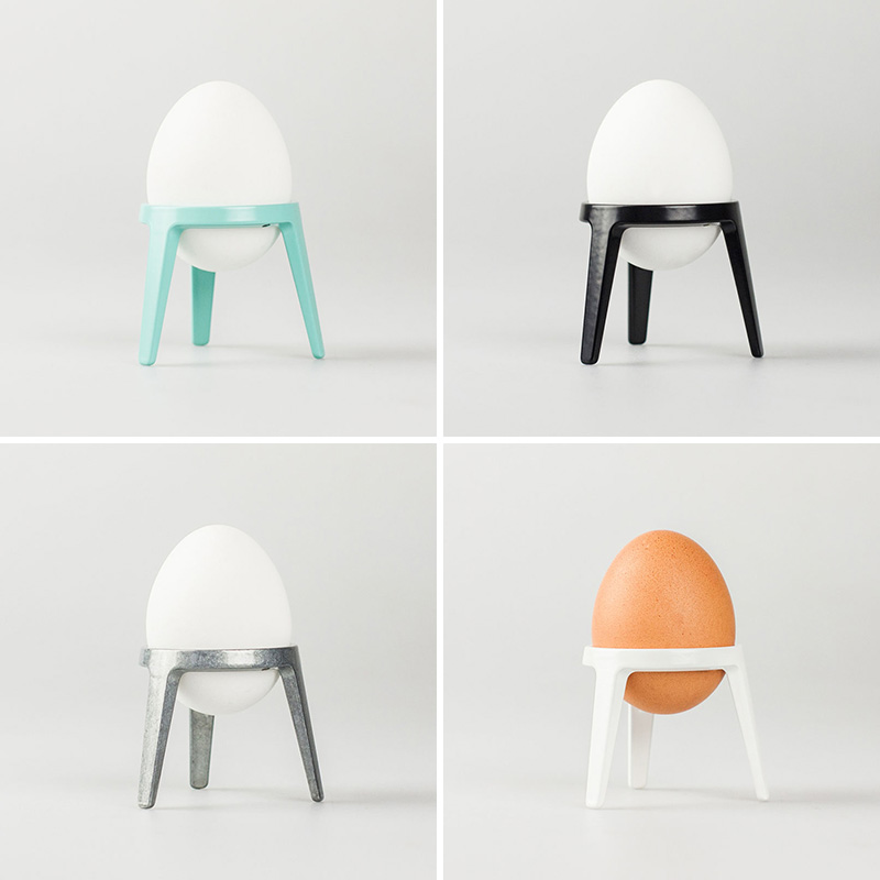 These modern metal egg cups were inspired by rocket ships, sitting in their base right before takeoff.