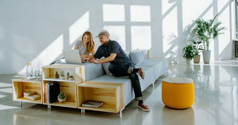 Designer Trevor Hoiland has created The Story Collection, a modern and modular office furniture series that's made with a wood storage cubby at the end of the seats, coffee tables and benches.