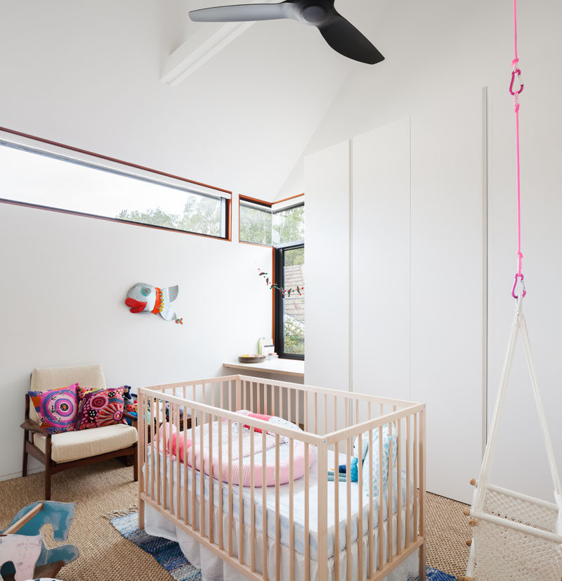 This mostly white nursery has clerestory windows that allow natural light to fill the room without it being too bright.