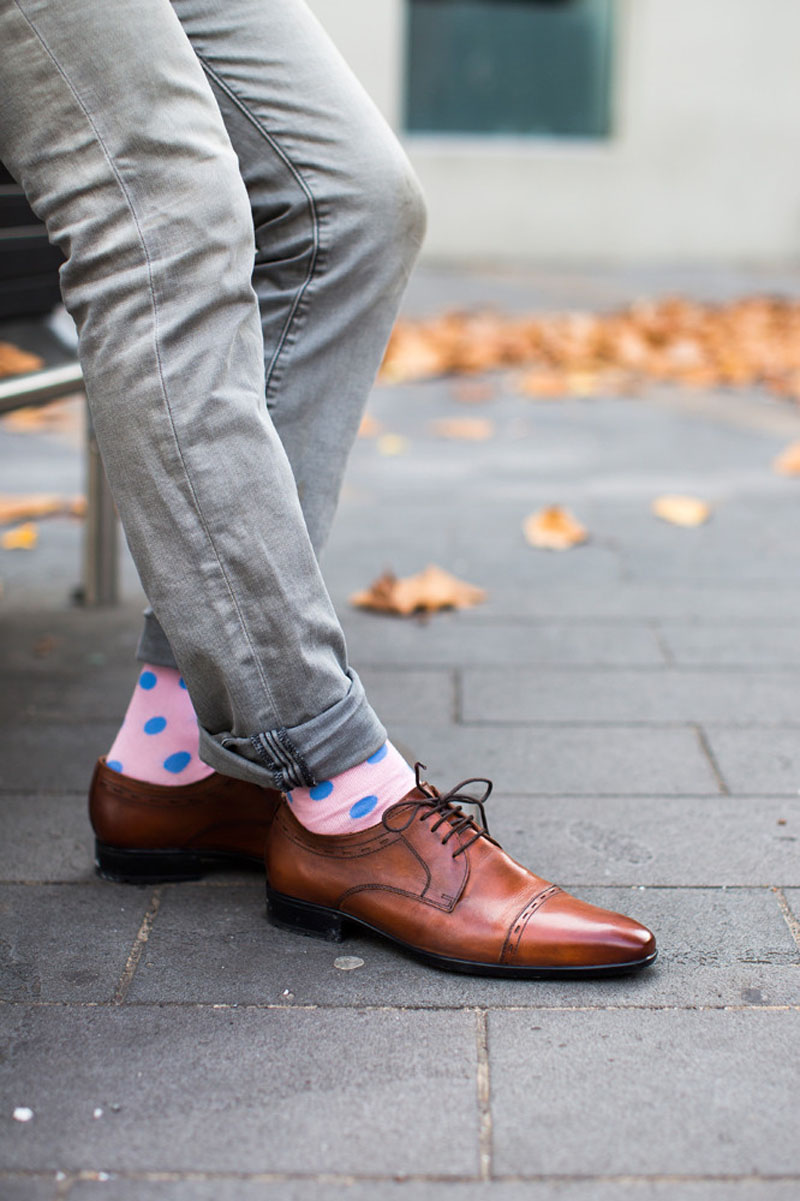 For a more subtle statement, these modern pink and blue polka dot socks are the perfect solution.