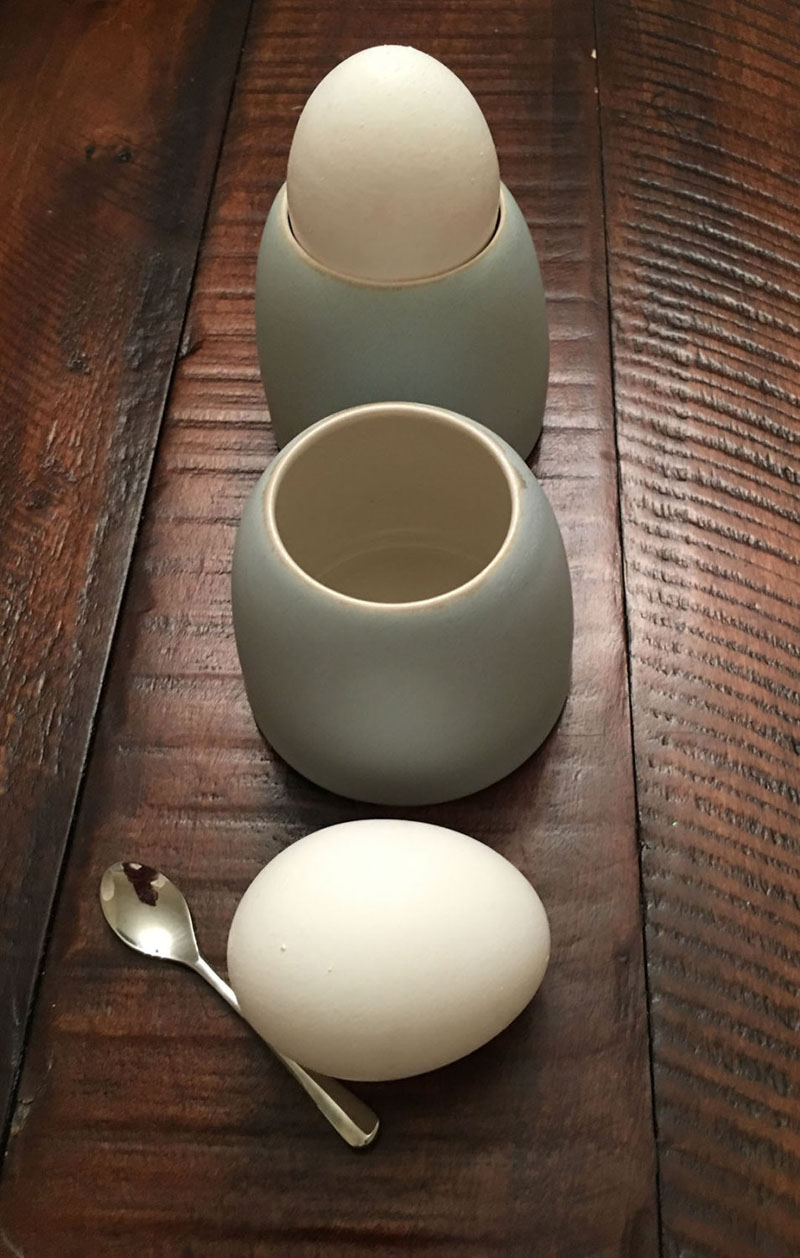 These modern light blue porcelain egg cups are delicate in design, and easy to use due to it's dome shape.