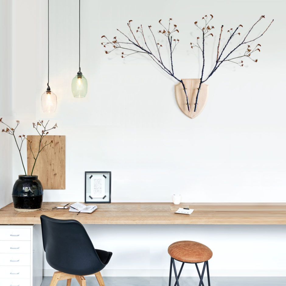 This modern raw wood board vase lets the branches be the main attraction in this rooms decor.