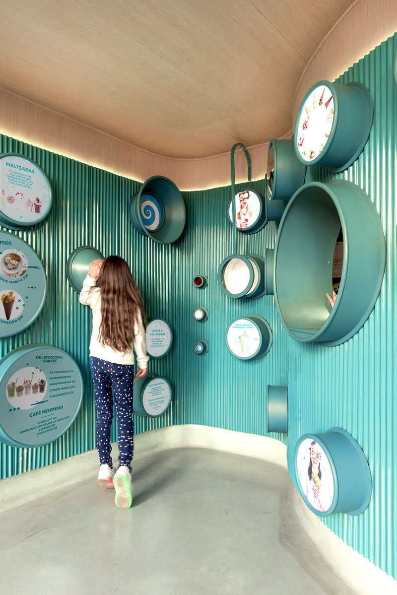 Esrawe + Cadena have designed Gelatoscopio, an fun and brightly colored modern gelato shop in Mexico, that features a curved teal blue interior, and is open to the outdoors.