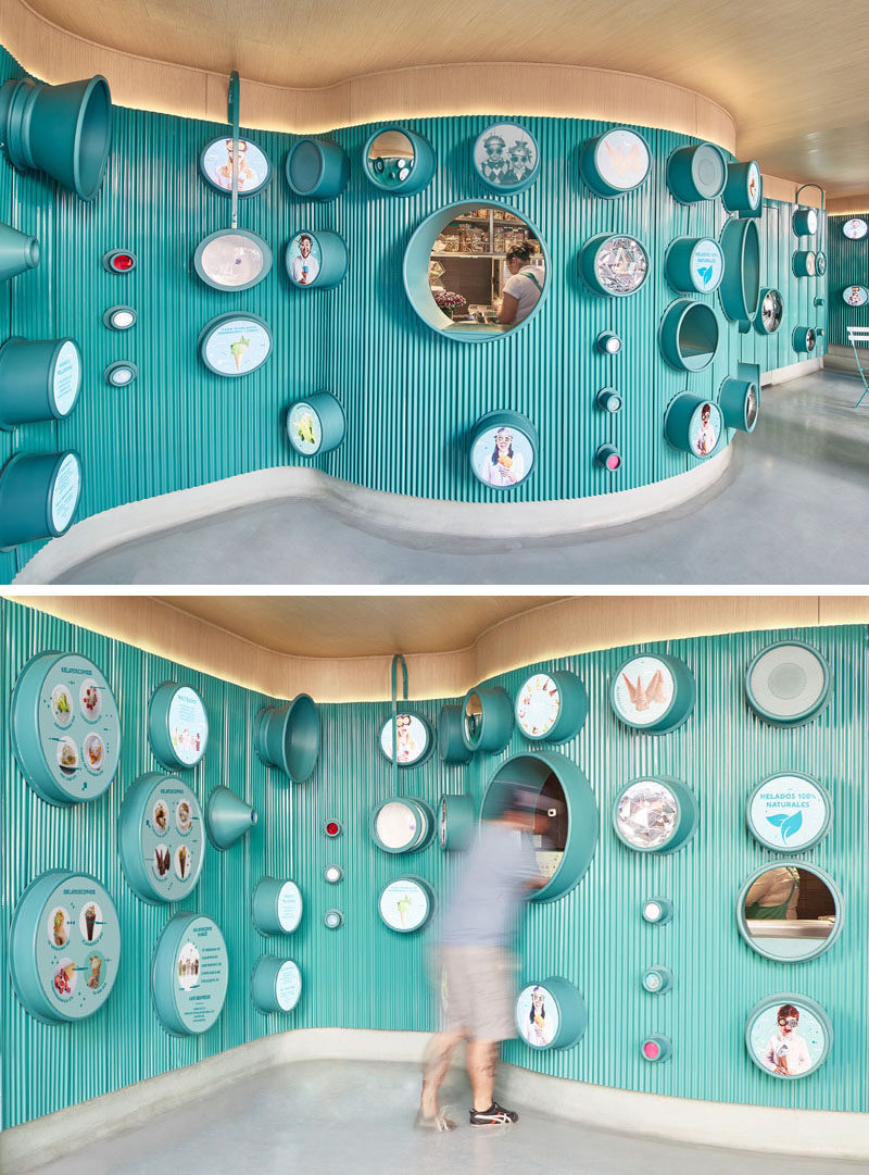 Inside this modern ice cream shop, the menu is located within the different lenses on the wall, and from this angle, you can see how the interior curves in the space.