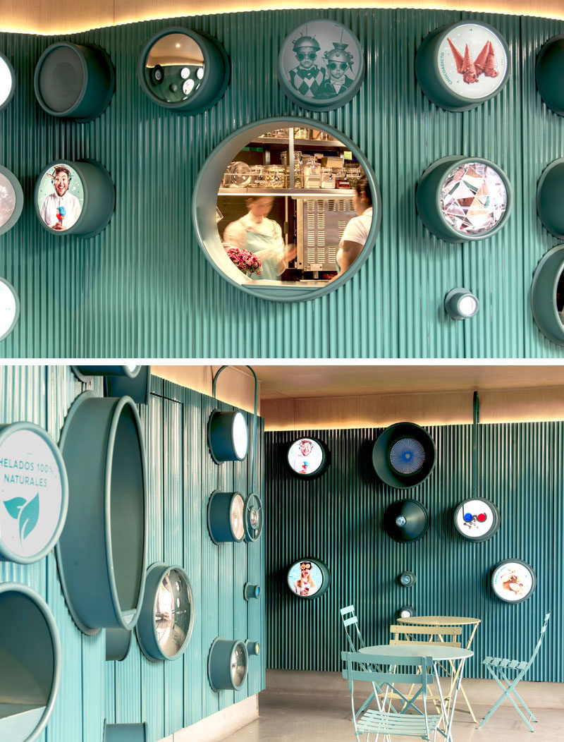 This modern ice cream shop has large open circles as order and pickup windows and as they are open, they offer a glimpse of the kitchen.