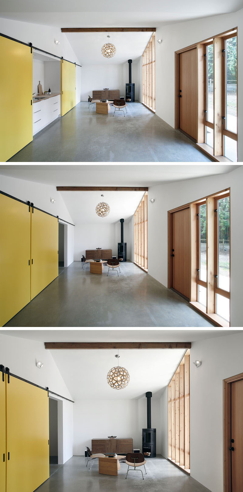Fun, bright yellow sliding barn doors run the length of this small home and conceal the bedroom and the kitchen, as well as adding a pop of color to the simple interior.