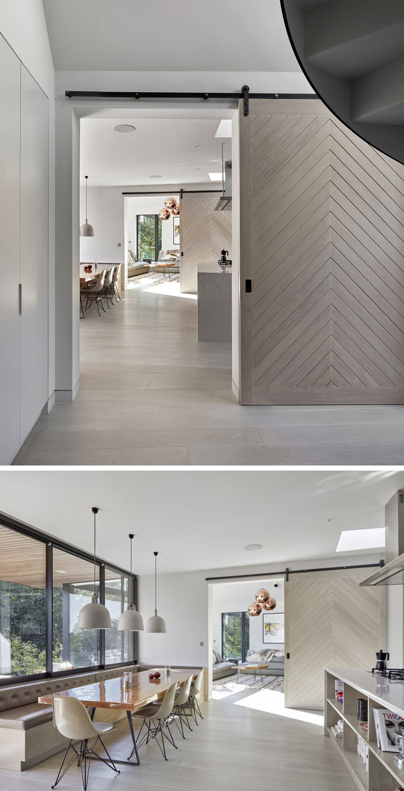 The chevron pattern on these sliding doors give the home a modern look and help divide the space when necessary but also keep the rooms connected.