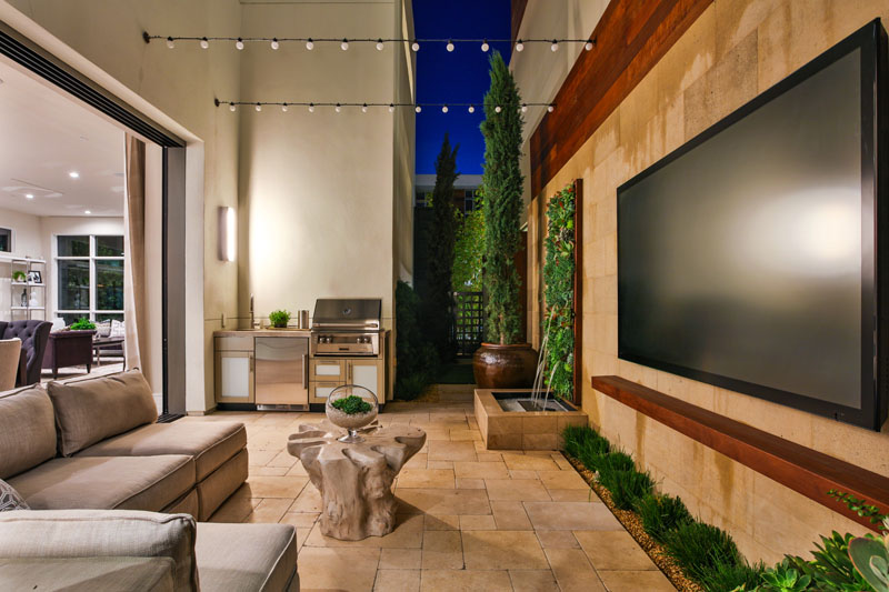 This modern small patio space has been created to flow from inside to outside, and is designed for entertaining.