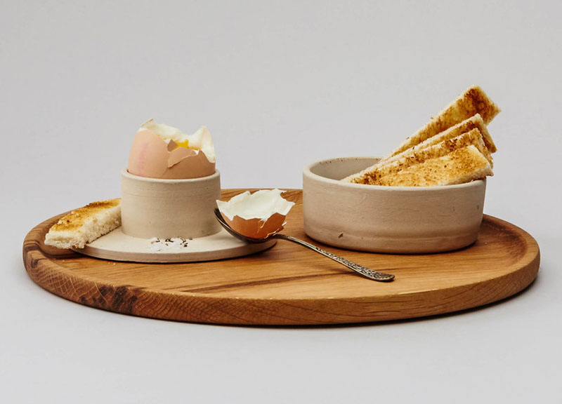 This modern stoneware egg cup has a wide base that provides a spot to rest your spoon on or place shell pieces on.