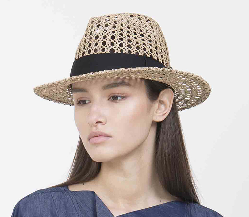 Yael Cohen, a fashion designer based in Israel, has created this Fedora with a black band as part of a collection of modern straw hats that are perfect for summer.