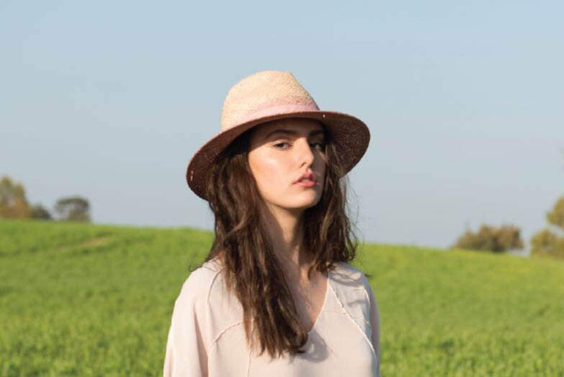 Yael Cohen, a fashion designer based in Israel, has created this light straw and pink Fedora as part of a collection of modern straw hats that are perfect for summer.