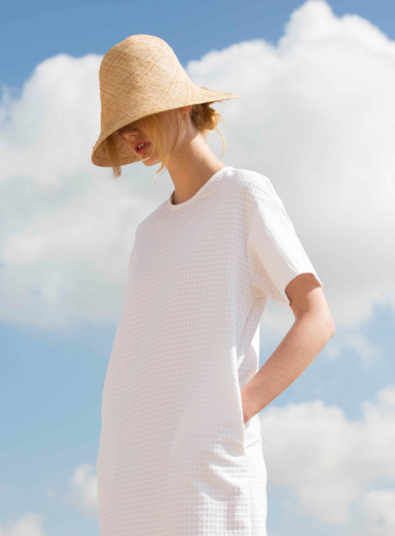 Yael Cohen, a fashion designer based in Israel, has created a line of modern straw hats that are perfect for summer, like this light colored bucket hat.