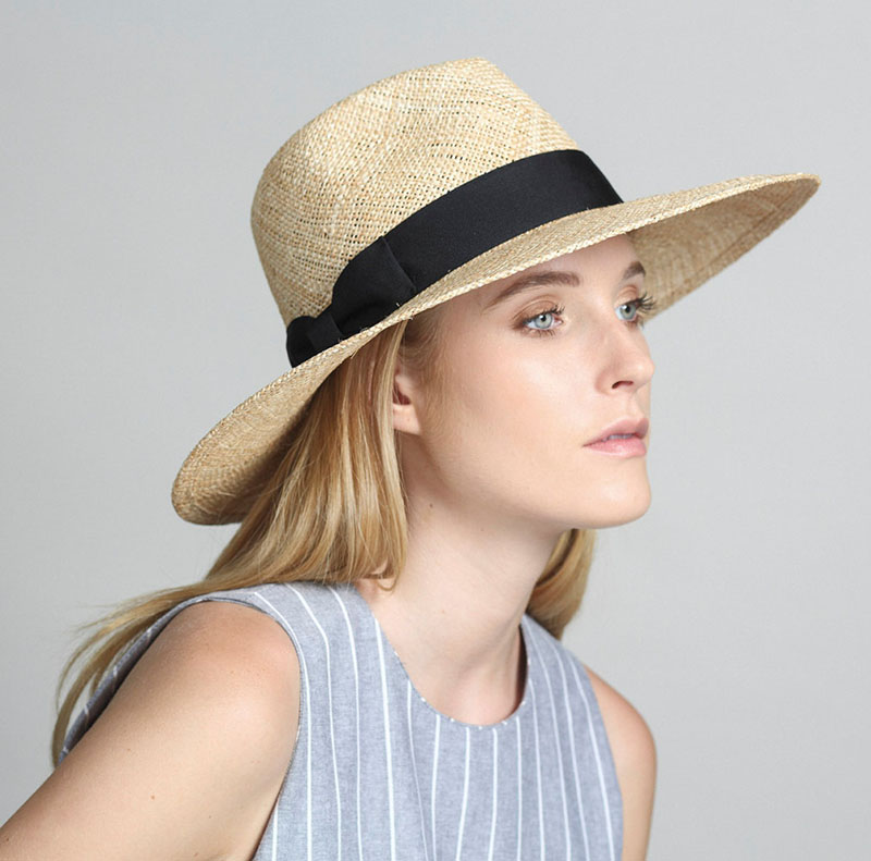 Yael Cohen, a fashion designer based in Israel, has created this white brim hat with black band as part of a collection of modern straw hats that are perfect for summer.