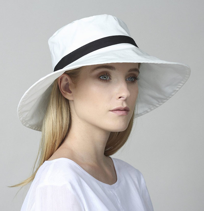 Yael Cohen, a fashion designer based in Israel, has created this white and black white brim hat as part of a collection of modern hats that are perfect for summer.