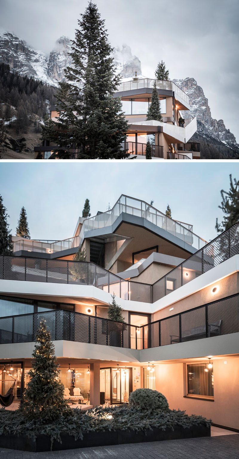 noa* have redesigned Hotel Tofana in Italy, with terraces and balconies are lined with coniferous trees and plants, which are connected by vertical ramps and stairs, creating an illusion of a summit for the hotel.