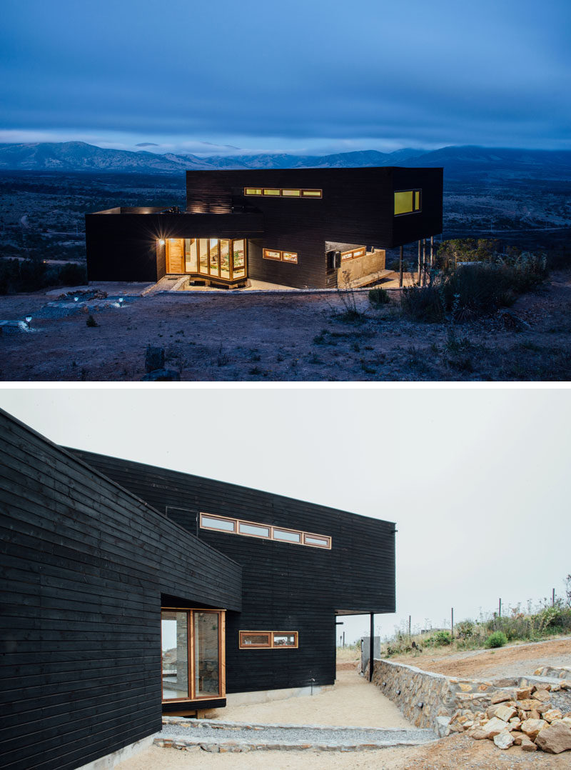 This modern black house has burnt wood siding (shou sugi ban), while lighter wood frames the windows and doors.