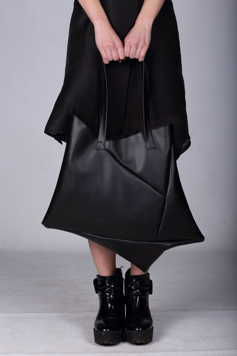 This modern, black vegan leather tote has a geometric design that makes it stand out from the rest.